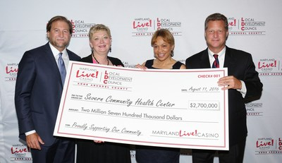 Maryland Live! Casino and Anne Arundel County today awarded more than $18.6 million in local impact grants for fiscal year 2017 to various grant recipients as recommended by the Local Development Council (LDC), which helps to manage the allocation of county gaming tax revenue to local organizations. Joe Weinberg, Managing Partner of The Cordish Companies (far left); Anne Arundel County Executive Steve Schuh (far right); and Claire Louder, Chair of the LDC, (2nd from left) officially presented the grants, including one for $2.7 million to Severn Community Center Executive Director Faye Royale-Larkins. (2nd from right).