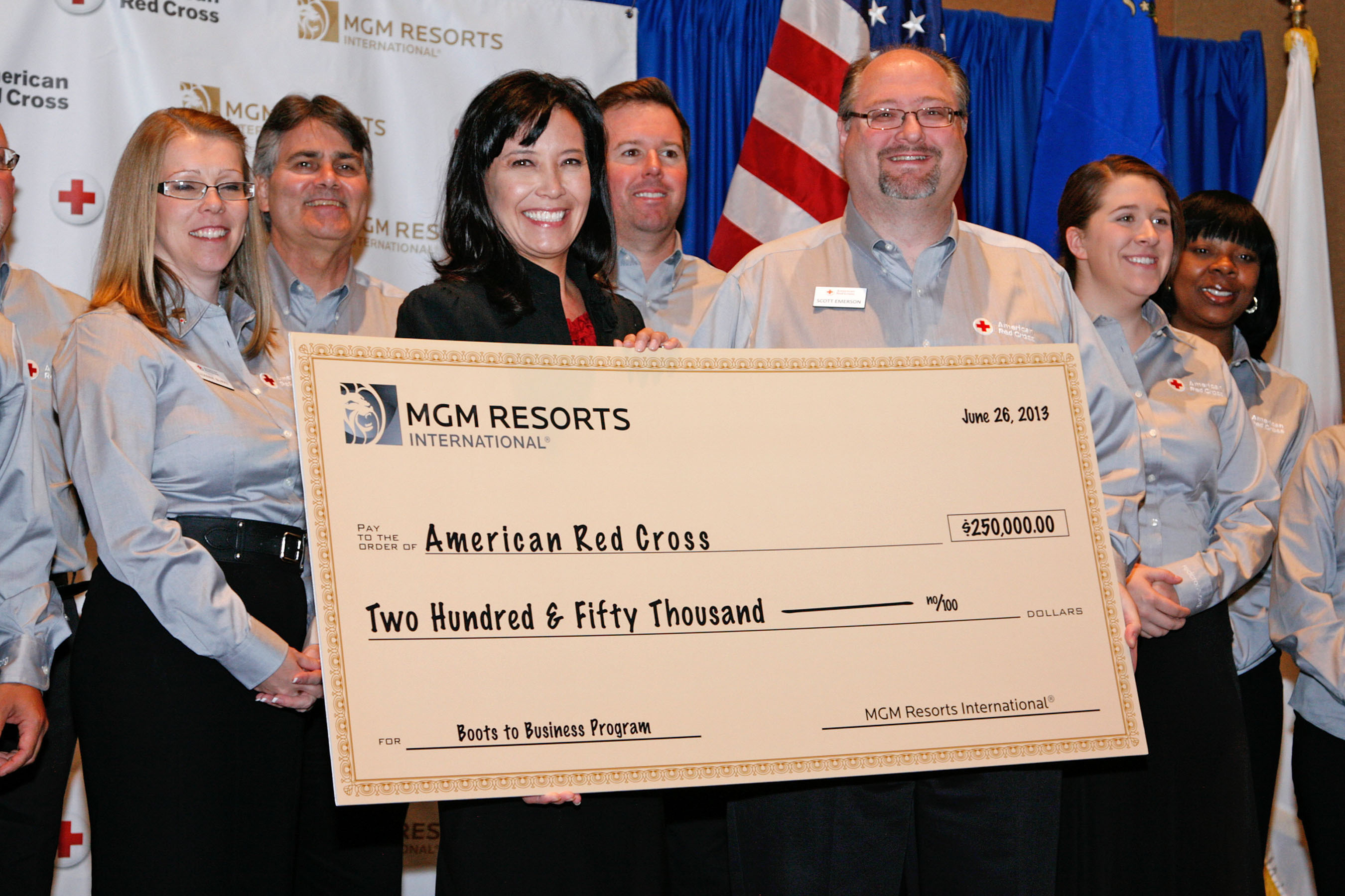 Through a grant of $250,000, MGM Resorts International is partnering with American Red Cross to expand Boots to Business, a hands-on management training program designed to help employ recent U.S. veterans. Pictured (l. to r.) at the June 26 presentation of the donation are Michelle DiTondo, Senior VP of Human Resources for MGM Resorts and Scott Emerson, CEO of the American Red Cross of Southern Nevada.  (PRNewsFoto/MGM Resorts International)