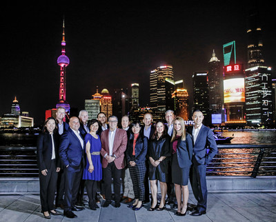 Pictured (left to right) is the Norwegian Cruise Line Holdings (NCLH) team on the Bund in Shanghai: Kimberly Leung, William Harber, David Herrera, Robin Lindsay, Winnie Chan, Simon Ho, Frank Del Rio (NCLH CEO), Richard Ambrose, Dorothy Mak, Harry Sommer, Constance Seck, Mark Kansley, Carmen Santamaria, and Caleb Wang.