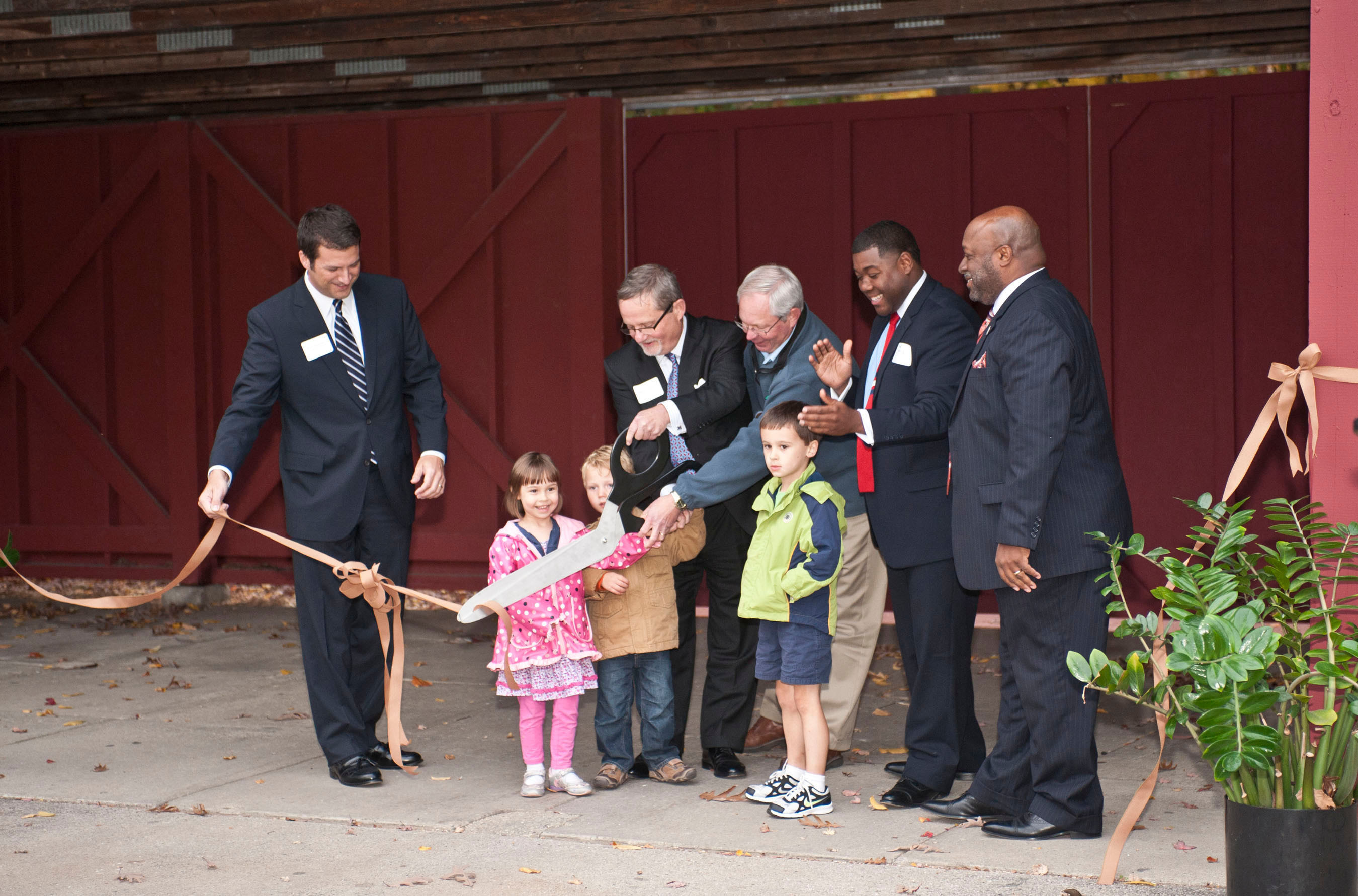 Officials from the Northwestern Mutual Foundation, the Milwaukee County Zoo and the Zoological Society of Milwaukee unveil the newly renovated Northwestern Mutual Family Farm.   (PRNewsFoto/Northwestern Mutual)