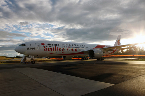 "China's ""Smiling China"", a B777-300ER, made its maiden flight Beijing-New York on March 31, 2013.  (PRNewsFoto/Air China)"