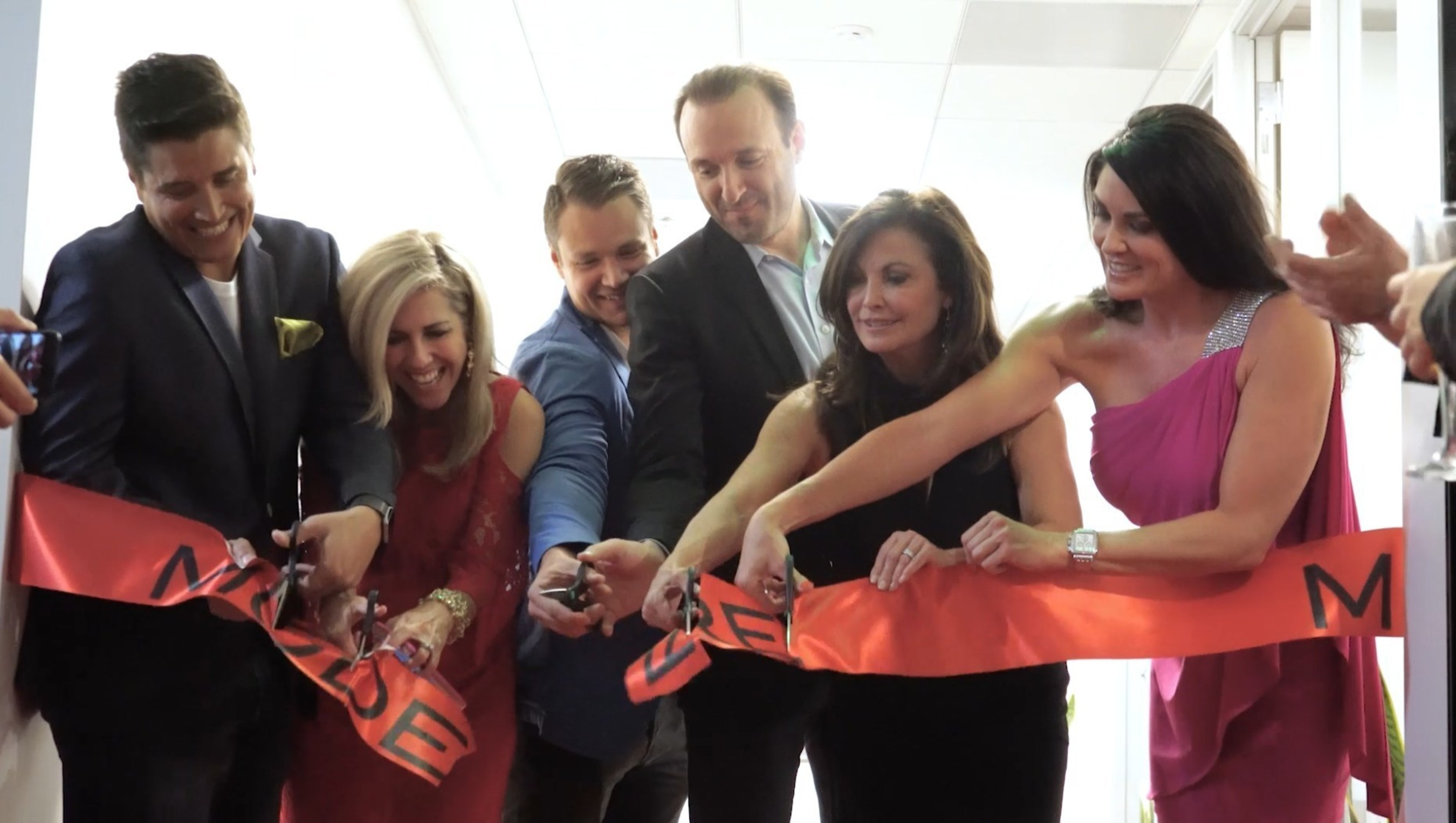 Ribbon cutting at Modere