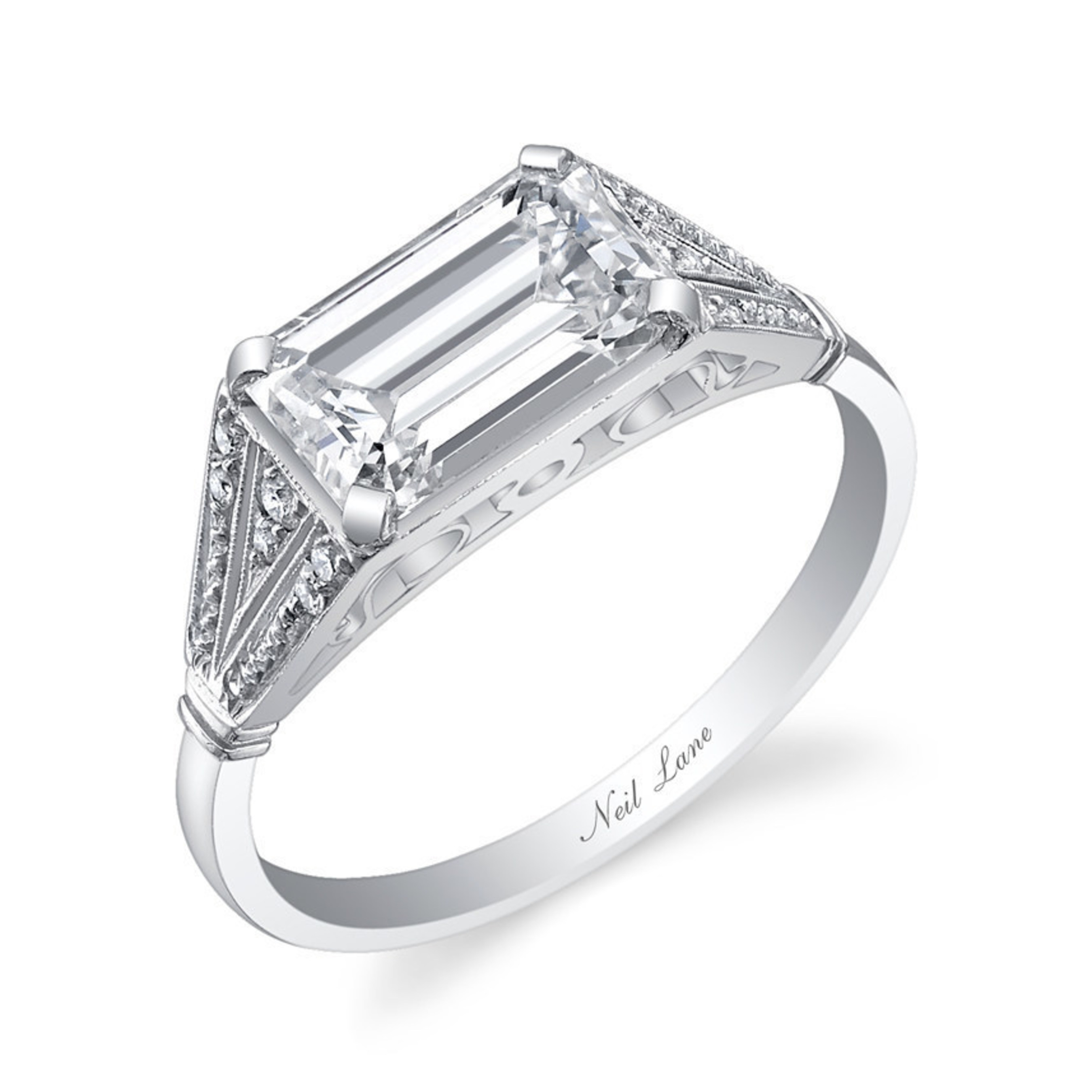 Tanner Tolbert proposed to Jade Roper on the season finale of Bachelor in Paradise with this stunning engagement ring handcrafted, designed and signed by Neil Lane. The diamond and platinum ring is centered on an emerald cut diamond, which is set horizontally. The ring is further accented with 12 round brilliant cut diamonds. Approximate total weight of all diamonds is 2-carats.