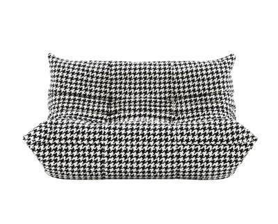 The Togo sofa covered in houndstooth-printed Alcantara.  (PRNewsFoto/Alcantara)