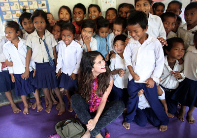 UNICEF Ambassador, Selena Gomez enjoys a sweet moment with a student while the early childhood education class gathers for a group photo at Satbariya Rapti Secondary School. Photo Credit: Courtesy of U.S. Fund for UNICEF/Josh Estey/MataHati (PRNewsFoto/U.S. Fund for UNICEF, Josh Estey/MataHati)