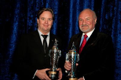 Team co-owners Kevin Kalkhoven and Jimmy Vasser of KV Racing Technology also accepted a BorgWarner Championship Team Owner's Trophy(TM).  (PRNewsFoto/BorgWarner Inc./Pat Bafile, P.B. Photographics)