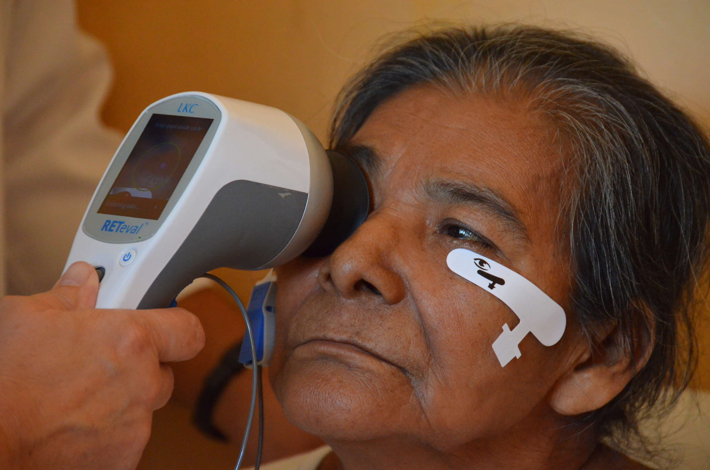In a Nicaraguan eye clinic, the functioning of this woman's retina is tested with a RETeval(TM) ERG/VEP visual electrophysiology device.