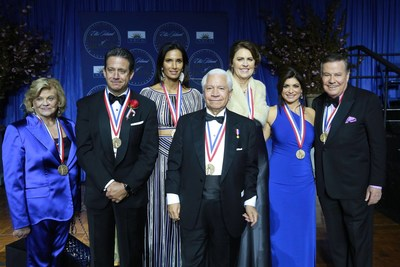 Photo Caption (left to right): Lorraine Thomas, philanthropist and co-founder of The Dave Thomas Foundation for Adoption, Bill Evans, meteorologist WABC-TV, Padma Lakshmi, TV host, Nasser J. Kazeminy, Chairman of the National Ethnic Coalition of Organizations-NECO, Ali Torre, co-founder of the Joe Torre Safe At Home Foundation, Tamsen Fadal, News Anchor WPIX-TV and Marvin Scott, Senior Correspondent WPIX-TV attend the National Ethnic Coalition of Organization's 2016 Ellis Island Medals of Honor awards ceremony on Ellis Island. (Photo by Amy Sussman AP Images)