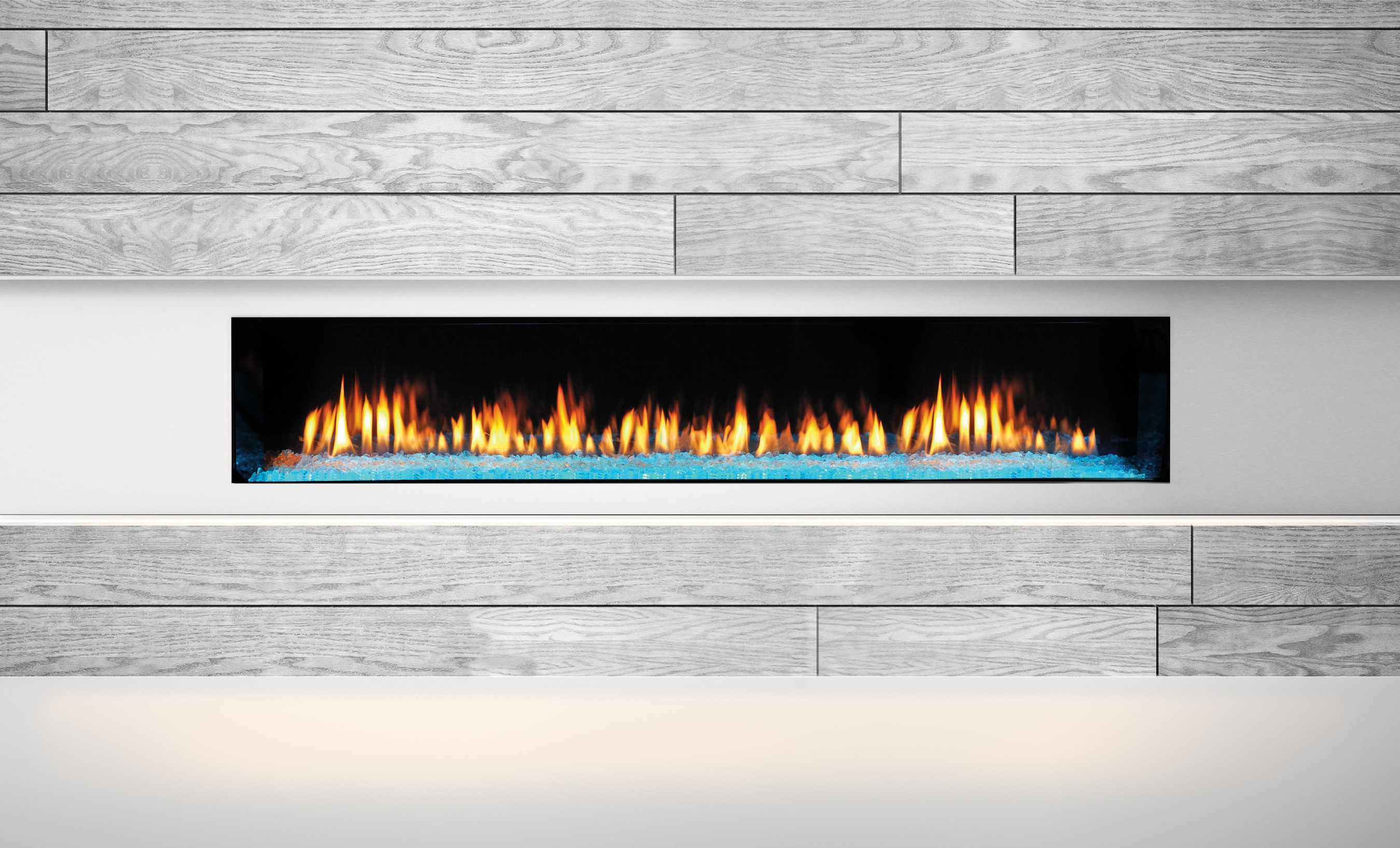 A sophisticated take on contemporary styling, the Heat & Glo PRIMO gas fireplace gives homeowners complete design freedom. Zero restrictions on finishing materials - including barnwood - eliminate concerns of overheating or safety hazards and offer the ability to safely hang a TV or valuable art above the fireplace for a completely custom look. Plus, the PRIMO features exclusive PowerFlow(TM) Heat Management Technology, which provides heat and flame control at the flip of a switch, allowing homeowners to comfortably enjoy the ambiance and beauty of a fireplace year-round.