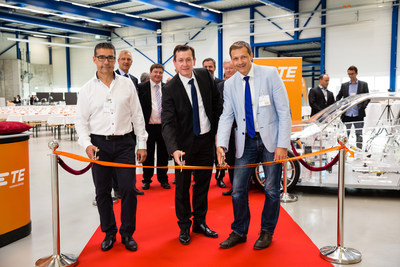 Pictured front left to right: Robert Wirth, Project Partner, Stephan Humpf, TE Plant Manager, and Roland Brandli, Mayor of Steinach during the ribbon cutting ceremony with TE Automotive leaders and other event attendees.