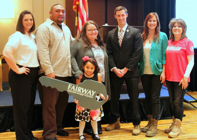 "U.S. Army veteran Max Poyer, his wife, Beverly and daughter Brianna receive the ""key"" to their new four-bedroom home from Fairway Independent Mortgage. Pictured from left are Andrea Dellinger of the Military Warriors Support Foundation, the Poyers, U.S. Marine Sgt. Joey Jones, Meghan McDermott of the Boot Campaign, and Louise Thaxton, director of Fairway's Military Mortgage Division.  (PRNewsFoto/Fairway Independent Mortgage Corporation)"