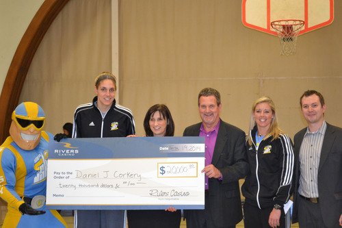 Left to Right: Chicago Sky Mascot, Sky Guy, Chicago Sky Forward, Elena Delle Donne, Daniel J. Corkery Elementary School Principal, Carol Devens-Falk, Rivers Casino General Manager, Bill Keena, Chicago Sky Assistant Coach, Christie Sides and Rivers Casino Promotions & Special Events Manager, Joey Hernandez.  (PRNewsFoto/Rivers Casino)
