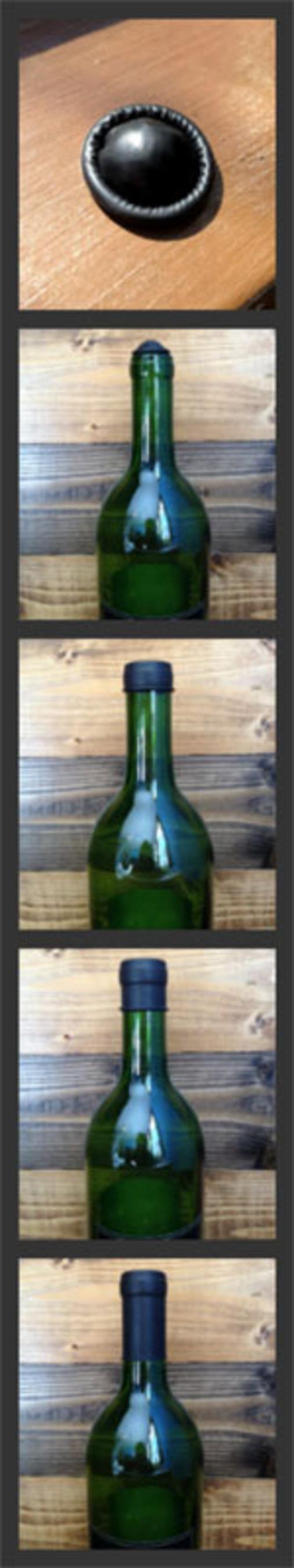 Wine Condom Demonstrated.  (PRNewsFoto/WINE CONDOM)