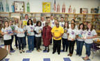Library Volunteers: Dr. Glenda Price, President of Detroit Public Schools Foundation and Ronald Alexander, Principal of Spain Elementary-Middle School surrounded by Ally volunteers. Ally delivered 50 new library books and school supplies to Spain students on Friday.