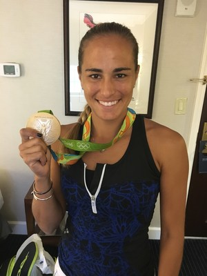 Monica Puig Celebrates her Olympic Gold Medal and urges travelers to visit her homeland. (Photo Credit: Puerto Rico Tourism Company)