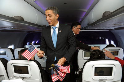 In this photo released by Virgin America Airlines and transmitted via WiFi at 35000 feet,  presidential impersonators Mitt Romney (Jim Gossett) and President Obama (Reggie Brown) work both sides of the aisle, encouraging passengers to register to vote via the airline's in-flight entertainment screens.  The airline partnered with Rock the Vote to encourage mile high voter registration and celebrate its first flight from San Francisco International Airport to Washington's Reagan National Airport (DCA), Tuesday, August 14, 2012. (AP Photo/Virgin America, Bob Riha, Jr.).  (PRNewsFoto/Virgin America)