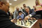 Rep. Chaka Fattah (D-PA) and Garry Kasparov watch as Jeffrey Xiong and Rep. Blaine Luetkemeyer make their next move at the first-ever Congressional Chess Match at the Rayburn House Office Building on Wednesday, June 18, 2014 in Washington, DC. (Photo by Paul Morigi/Invision for Invision for Saint Louis Chess Club/AP Images) (PRNewsFoto/Chess Club and Scholastic Center)