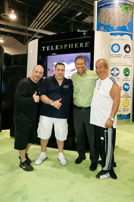 Largest Telephone Aquarium in the World -- Tanked stars create magic for national telecommunications provider Telesphere with a 3,200 pound, 8-foot-tall, 300-gallon custom aquarium. (Left to Right) Brett Raymer, Tanked; Wayde King, Tanked; Clark Peterson, CEO Telesphere; Irwin Raymer, Tanked. Episode airs on Animal Planet's hit show Tanked, Friday, April 4th, 10 p.m. (ET, PT/9 p.m. Arizona). The aquarium, which celebrates Telesphere's new MobileConnect product, will be permanently installed at Telesphere headquarters in Scottsdale. (PRNewsFoto/Telesphere) (PRNewsFoto/TELESPHERE)