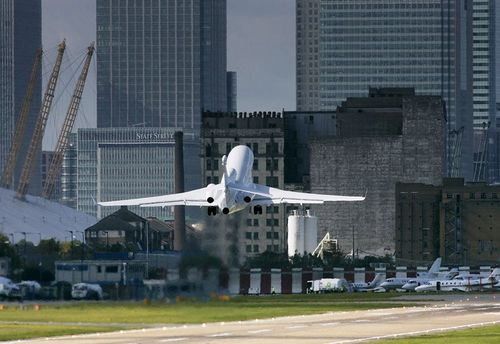 Dassault Falcon 900EX taking off from London City Airport