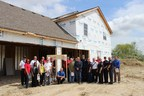 Firefighters and building and elected officials at one of the first fire sprinkler-protected homes in the Manhattan Fire Protection District in Illinois.