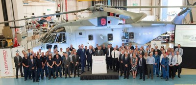 Members of the Industry team of Lockheed Martin and Leonardo mark a major milestone of the delivery of the 30th and final Merlin Mk2 to the UK's Ministry of Defence.