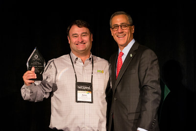 (Left - PLS(R) Financial Services' SVP and Chief Marketing Officer, Aaron Caid receives the 2015 FiSCA(R) STAR AWARD on behalf of PLS(R) at the 2015 Financial Services Centers of America Annual Conference in Orlando, Florida.)