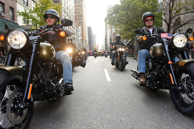 """Christian Walters, left, of Harley-Davidson, and Dorsey """"Barney"""" Fyffe, right, a Wounded Warrior Project Peer Mentor, ride in the 2015 America's Parade on Veterans Day, Wednesday, Nov. 11, 2015, in New York, to announce the extension of """"Operation Personal Freedom: Ride Free,"""" free Riding Academy motorcycle training to all active-duty military and veterans. (Photo by Diane Bondareff/AP Images for Harley-Davidson) (PRNewsFoto/Harley-Davidson Motor Company)"""