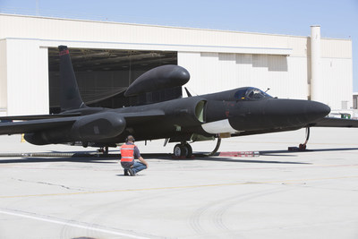 A technician completes final pre-flight checks on a U-2 Dragon Lady before an Open Mission Systems demonstration flight in which fighter aircraft from multiple generations and services exchange penetrating Intelligence, Surveillance, and Reconnaissance, Electronic Warfare and signals intelligence data.