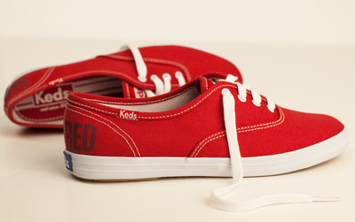 Keds(R) is excited to announce its partnership with Taylor Swift introducing these limited edition red Champions, commemorating the release of Swift's latest album, Red.  (PRNewsFoto/Keds)