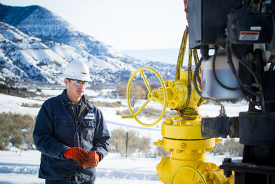 Canary, LLC employee working with a wellhead near a Grand Junction, CO rig.