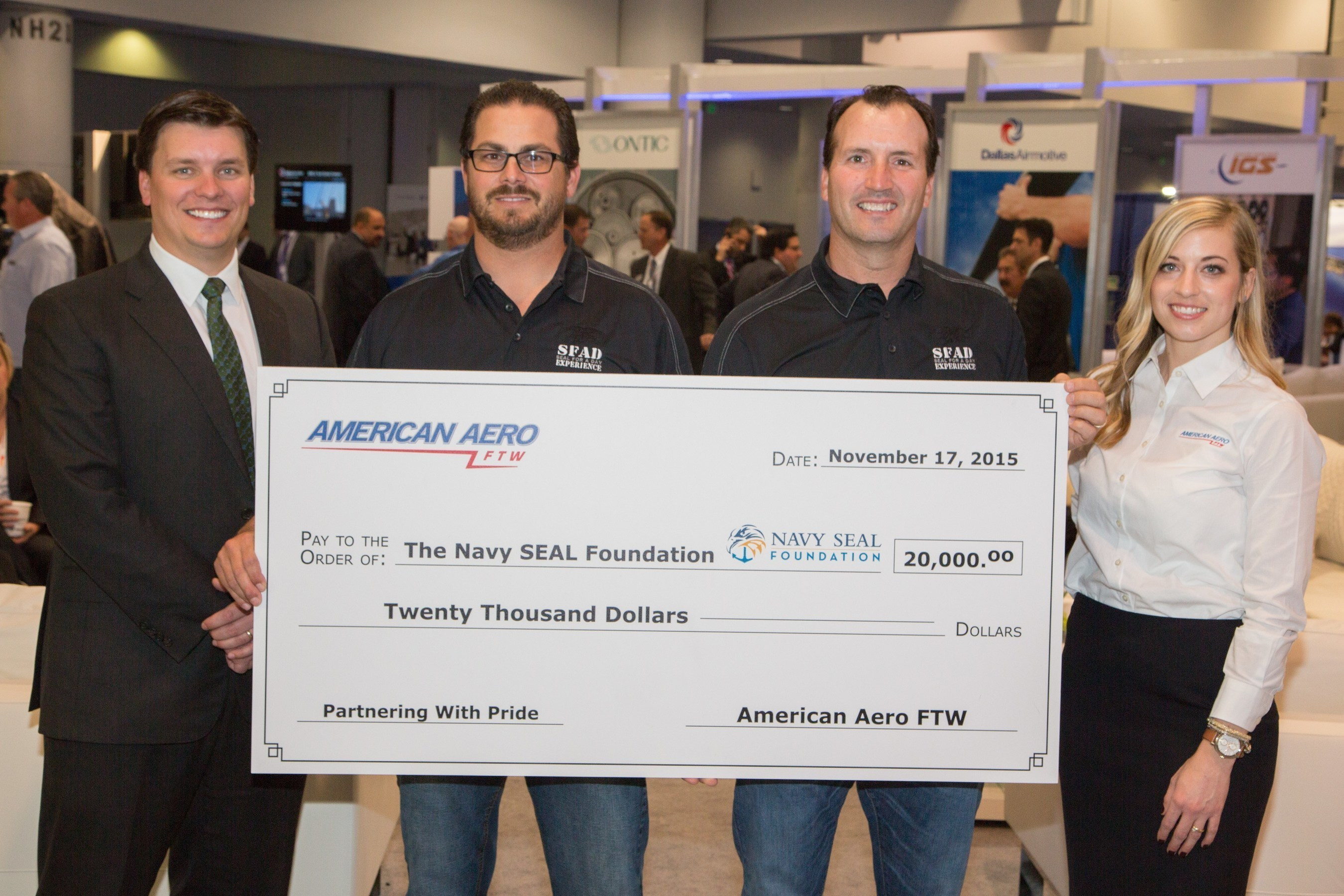American Aero FTW Delivers $20,000 Donation To The Navy SEAL Foundation At NBAA 2015 Convention In