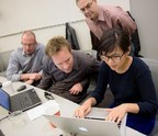 Collaborating at the recent Northwestern University Hackathon are (L-R) Teradata analytic experts Gregory Bethardy, Russell Ratshin and Roger Fried - with graduate student Jung-Hee Oh.