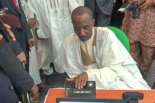The Governor of the Central Bank of Nigeria, Dr Sanusi Lamido Sanusi, was the first bank customer to register his fingerprint in DERMALOG's biometric system. (PRNewsFoto/DERMALOG Identification Systems)