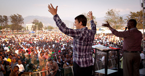 Andrew Palau speaks at the COTEBU grounds at the Love Burundi festival. An interpreter translates his message ...