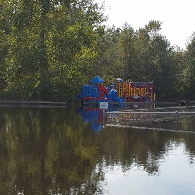 A playground underwater in Lumberton, NC on Oct. 14 after severe flooding from Hurricane Matthew.  Save the Children is working to help child care centers in North and South Carolina recover and reopen so distressed children can get back into safe, supportive care as soon as possible. Credit: Holly Spicer/Save the Children