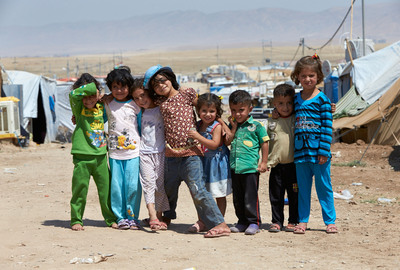 Syrian refugee children team up in the Domiz refugee camp, which is in the Kurdish part of Iraq. The living conditions in the camp are tough for the around 55,000 Syrian refugees who are staying there. Photo by Rob Holden.  (PRNewsFoto/Save the Children)