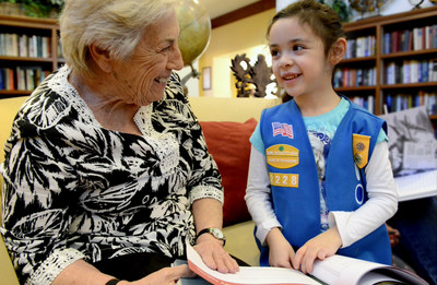 Atria resident and Girl Scout enjoy bonding over Atria Senior Living's Field Notes from an Adventurous Life: A Guided Journal.  The 130-page hardcover, award-winning journal provides a unique way for people to share their life stories and inspire future goals and aspirations. It was designed using vintage imagery, quotes and event-specific prompts to inspire interest and create conversation between multiple generations. Each of Atria's 21,000 residents have received a gift copy and a selection of youth groups, schools, staff and family members will be journaling along with residents across the country.