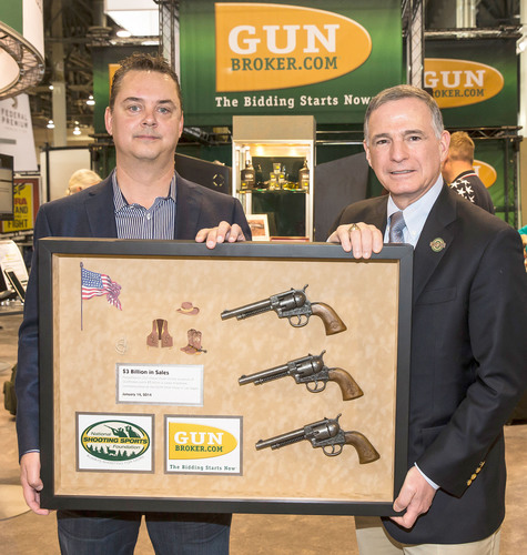 Steve Urvan, CEO of GunBroker.com is presented a commemorative plaque by Steve Sanetti, President & CEO of the NSSF. (PRNewsFoto/GunBroker.com) (PRNewsFoto/GUNBROKER.COM)