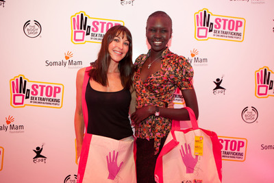 Tamara Mellon, OBE and Alek Wek, supermodel support The Body Shop Stop Sex Trafficking of Children and Young People Campaign.  (PRNewsFoto/The Body Shop)