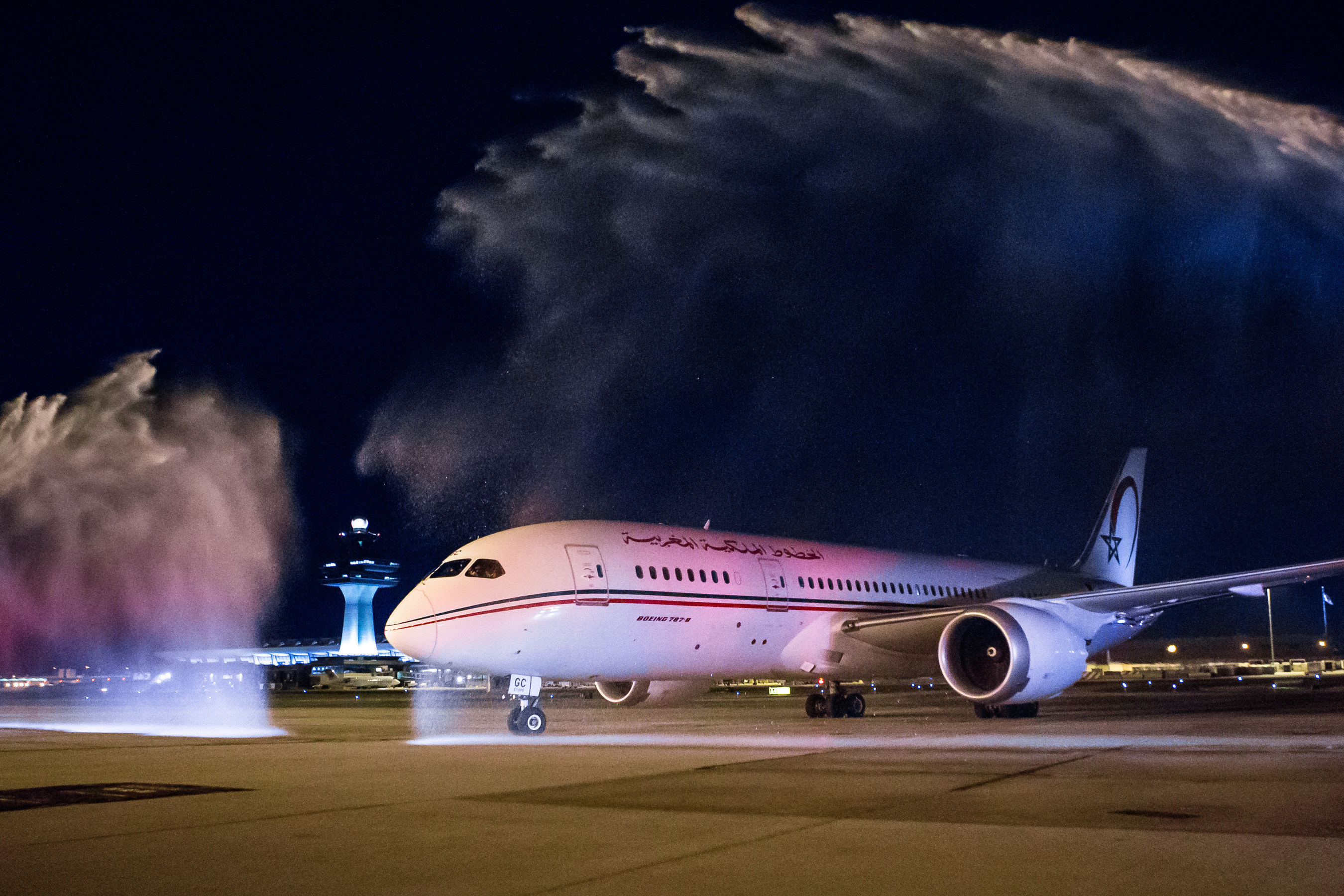 A Royal Air Maroc Boeing 787 Dreamliner taxis under a water cannon salute at Washington Dulles International Airport during an official welcome ceremony for the inaugural flight from Casablanca to Washington, D.C.