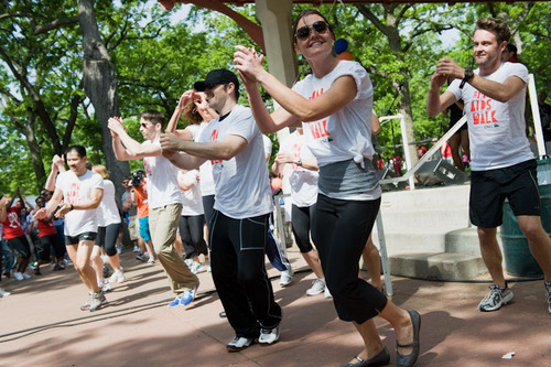 Participants limber up during opening ceremony festivities at the MN AIDS Walk in Minnehaha Park in ...