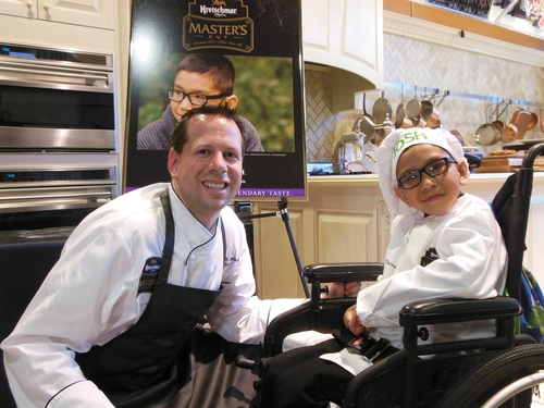 Certified Master Chef Brian Beland and Josh at his pizza demonstration (PRNewsFoto/Kretschmar Deli)