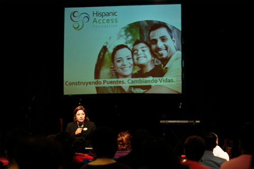 Maite Arce, president of Hispanic Access Foundation, addresses the crowd at a recent tax education workshop in ...