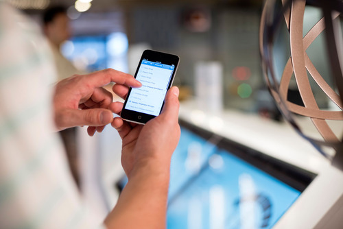 Using an iPhone on Crystal Serenity.  (PRNewsFoto/Crystal Cruises)