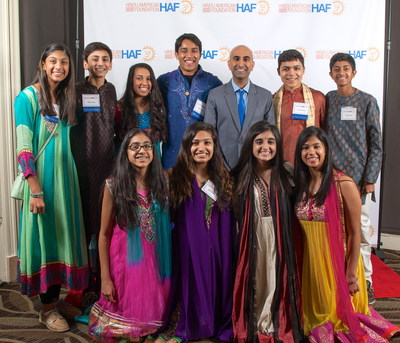 Comedian Rajiv Satyal poses with HAF-Dallas youth members