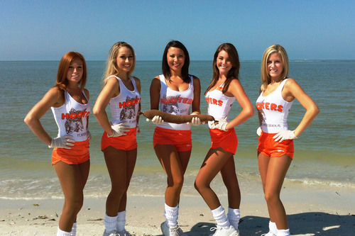 "Hooters Girls show how to get a ""leg up"" on the Gulf oil spill.  (PRNewsFoto/Hooters of America, Inc.)"
