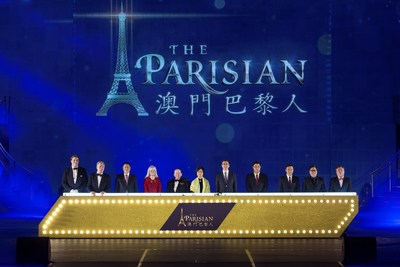 Guests of honor, including Las Vegas Sands and Sands China executives, and Macao government officials, officiate the grand opening of The Parisian Macao Tuesday.