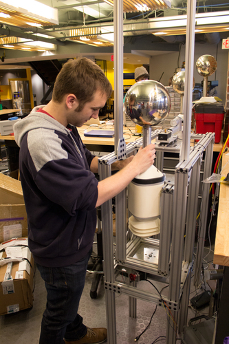 Understory co-founder Bryan Dow performs tests on a weather sensor in the Bolt engineering laboratory. (PRNewsFoto/Understory)