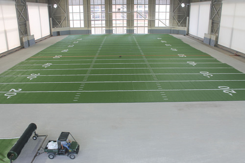 Construction of Oklahoma State University's Sherman E. Smith Training Center in progress.  AstroTurf's prefabricated turf panels are being unrolled for the first field.  (PRNewsFoto/AstroTurf)