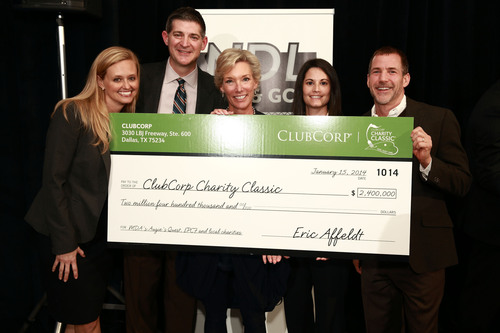 ClubCorp Chief Operating Officer Mark Burnett (second from left); Director Nicole Boyd (second from right), and Vice President Randy Kazmierski (far right) present the 2013 ClubCorp Charity Classic check to Shannon Shryne, Muscular Dystrophy Association (far left) and Lynn Nieto, Augie's Quest (middle). The Charity Classic, ClubCorp's major annual philanthropic effort, raised a record $2.4 million for more than 100 charitable organizations, including Muscular Dystrophy Association's Augie's Quest, the ClubCorp Employee Partners Care Foundation, and dozens of national and local charities. (PRNewsFoto/ClubCorp, Inc.) (PRNewsFoto/CLUBCORP, INC.)